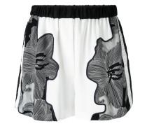 - floral-print shorts - women