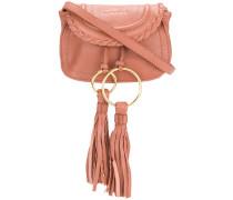 tassel embellished clutch