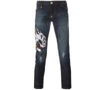 embroidered lion jeans