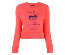 "Sweatshirt mit ""Love is""-Print"