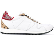 - Sneakers mit Einsätzen in Schlangenleder-Optik