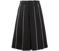 exposed seam pleated skirt