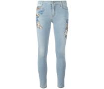 Skinny-Jeans mit Blumen-Patches