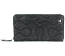 embossed zip around wallet