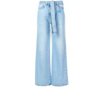 Weite Destroyed-Jeans mit Gürtel