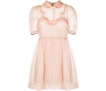Ausgestelltes Kleid mit Volant