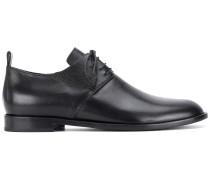 Schuhe mit runder Kappe