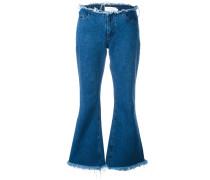 Ausgestellte Jeans mit Fransen