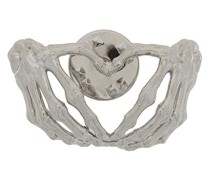 Brosche mit Skeletthänden
