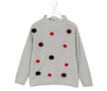 Pullover mit Bommeln