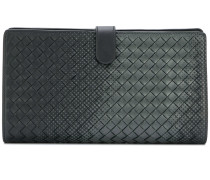gradient spotted clutch bag