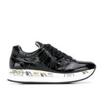 Conny crocodile-effect sneakers