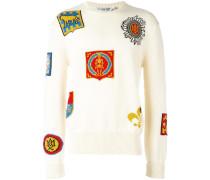 Intarsien-Pullover mit Wappenmuster