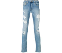 'Europe' Skinny-Jeans in Distressed-Optik