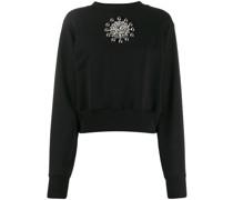 Sweatshirt mit Kristallbrosche