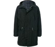 zipped-up parka coat