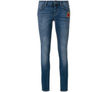 skinny jeans with Sacred Heart patch