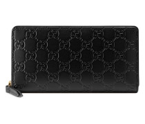 Signature zip around wallet - women - Leder