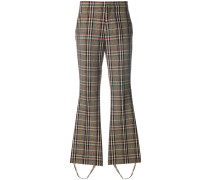 checked stirrup trousers