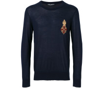 crest appliqué sweater
