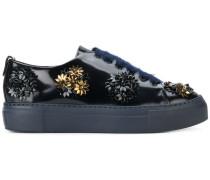 Sneakers mit floraler Verzierung
