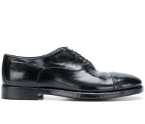 Glänzende Oxford-Schuhe