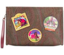 badge detail clutch bag