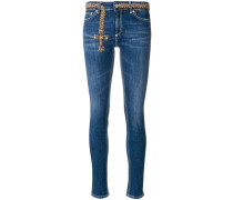 embroidered cross skinny jeans
