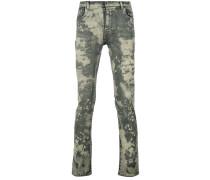 splattered skinny jeans