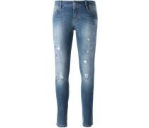 Skinny-Jeans mit Blumenapplikation