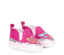 Schuhe mit Applikationen