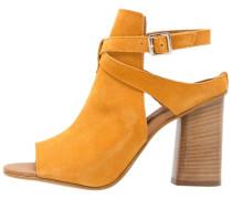 NICO High Heel Sandaletten mustard