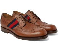 Webbing-trimmed Pebble-grain Leather Wingtip Brogues