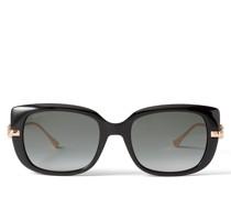 Orla Eckige schwarze Sonnenbrille mit mit Brillenbügeln in Kupfergold und JC Emblem