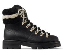 Eshe Flat Shearling Stiefel aus schwarzem genarbten Leder und Shearling in Schwarz und Naturfarben