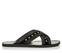 Wally Sandalen aus schwarzem glänzendem Leder mit goldenen Sternen