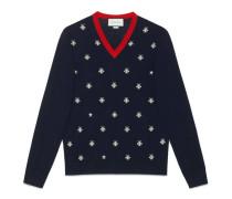 Pullover mit V-Ausschnitt aus Wolle mit Bienen und Sternen