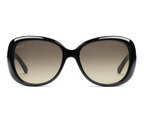 Glänzende schwarze übergroße Sonnenbrille mit Kontrast