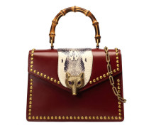Broche glossy leather top handle bag