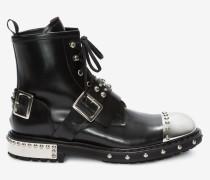 Stiefel mit Zehenkappe aus Metall und Schuhnägeln.