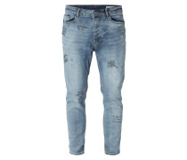 Tapered Fit Jeans mit Prints