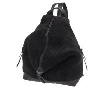 Rucksack aus Leder mit Besatz aus Lammfell