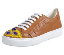 Sneaker mit Zierperlen und Fransen
