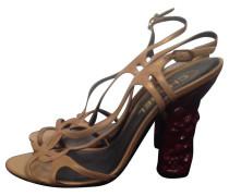 Second Hand High-Heels mit rotem Absatz
