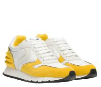 Sneaker aus Leder in Gelb