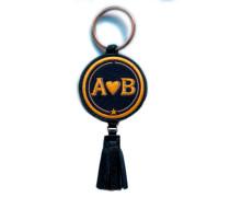 Schlüsselanhänger Love · gelb/beige · mit Tassel