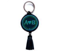 Schlüsselanhänger LOVE türkis/grün mit Tassel