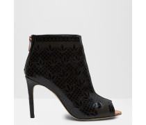 Hohe Leder-Ankle Boots mit gelasertem Muster