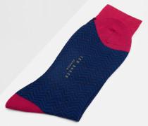 Gepunktete Socken mit Fischgrätmuster