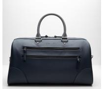 Reisetasche mit kontrastierendem Tragegriff